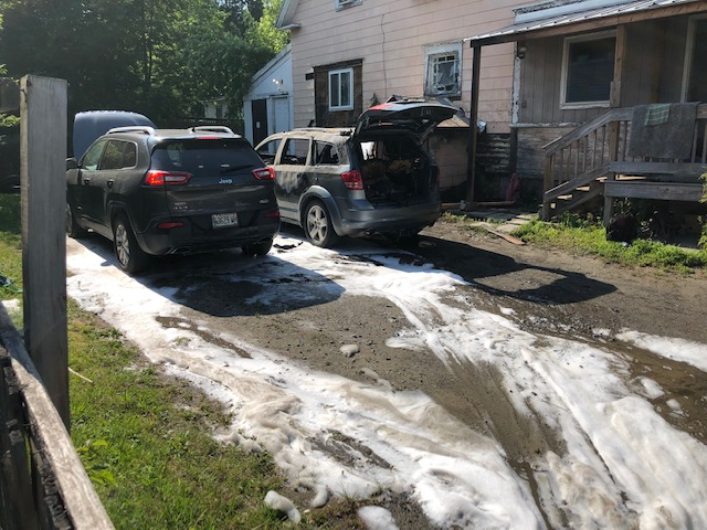 The state fire marshal's office was called to help investigate a fire that apparently started in one of these cars and also reached the house on Friday.