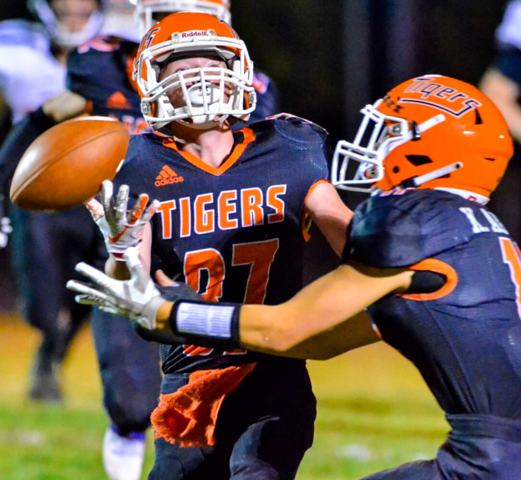 Gardiner defensive backs Gage Chase, left, and Kyle Adams juggle the ball during a game against Skowhegan earlier this season in Gardiner.