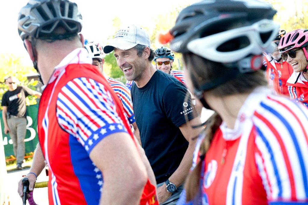 Patrick Dempsey greets the Challenge to Conquer Cancer riders at Simard-Payne Memorial Park in Lewiston in September. The team rides from South Carolina to participate in the Dempsey Challenge each year. Dempsey has been named honorary captain of the U.S. Olympic cycling team.
