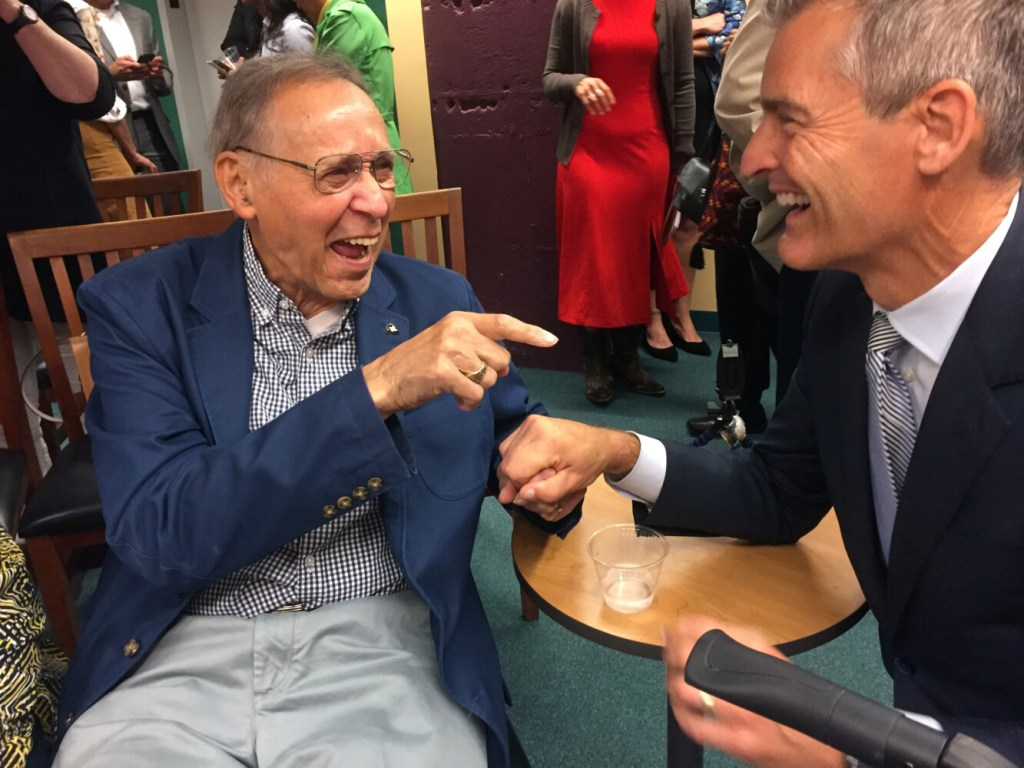 Gerald Talbot, Maine's first African-American legislator and a prominent black historian, shares a light moment Tuesday with Glenn Cummings, president of the University of Southern Maine, which has established a teaching fellowship in Talbot's honor that will be dedicated to race in Maine.