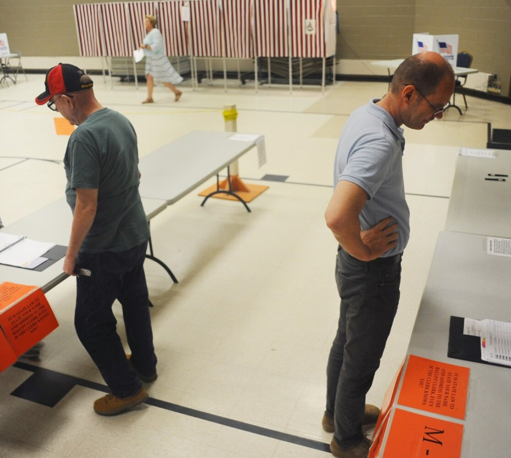 Voters arrive at the Fairfield Community Center Thursday to cast their ballots on whether or not to approve the school budget for School Administrative District 49. After twice failing to approve a budget, voters passed the latest proposal by an unofficial 373-206 margin.