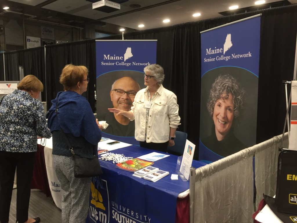 Anne Cardale, program director of the Maine Senior College Network, chats with people attending the Maine Wisdom Summit at the Augusta Civic Center on Tuesday. It's the sixth annual conference addressing the challenges of aging that are facing the oldest state in the nation.