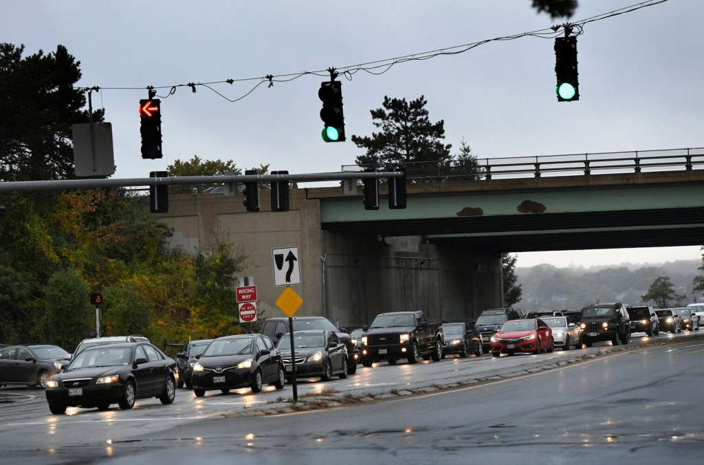 Traffic is backed up Friday morning at the intersection Franklin Street and Marginal Way. In a bid to ease congestion at the busy Interstate 295 interchange, the city is equipping traffic signals on Franklin Street with sensors that will assess traffic conditions and adjust the timing and coordination of the stoplights.