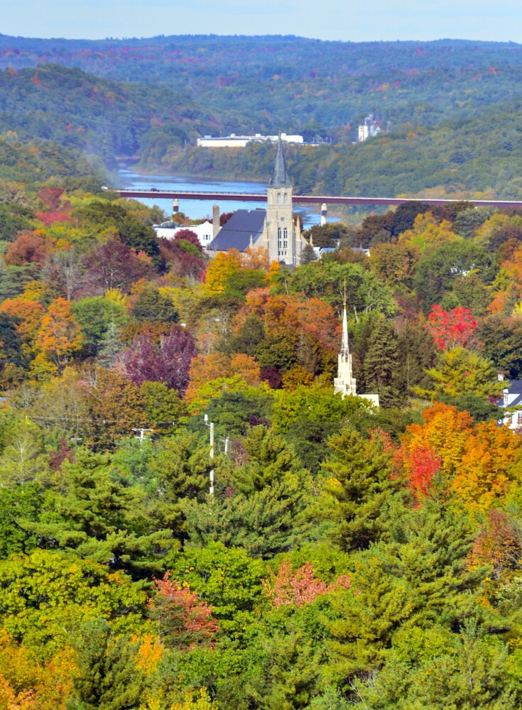 AUGUSTA, ME - OCTOBER 8: St. Augustine Catholic Church seen in front of Kennebec River  on Tuesday October 8, 2019 from scenic overlook in the Howard Hill Historical Park in Augusta. (Staff photo by Joe Phelan/Staff Photographer)