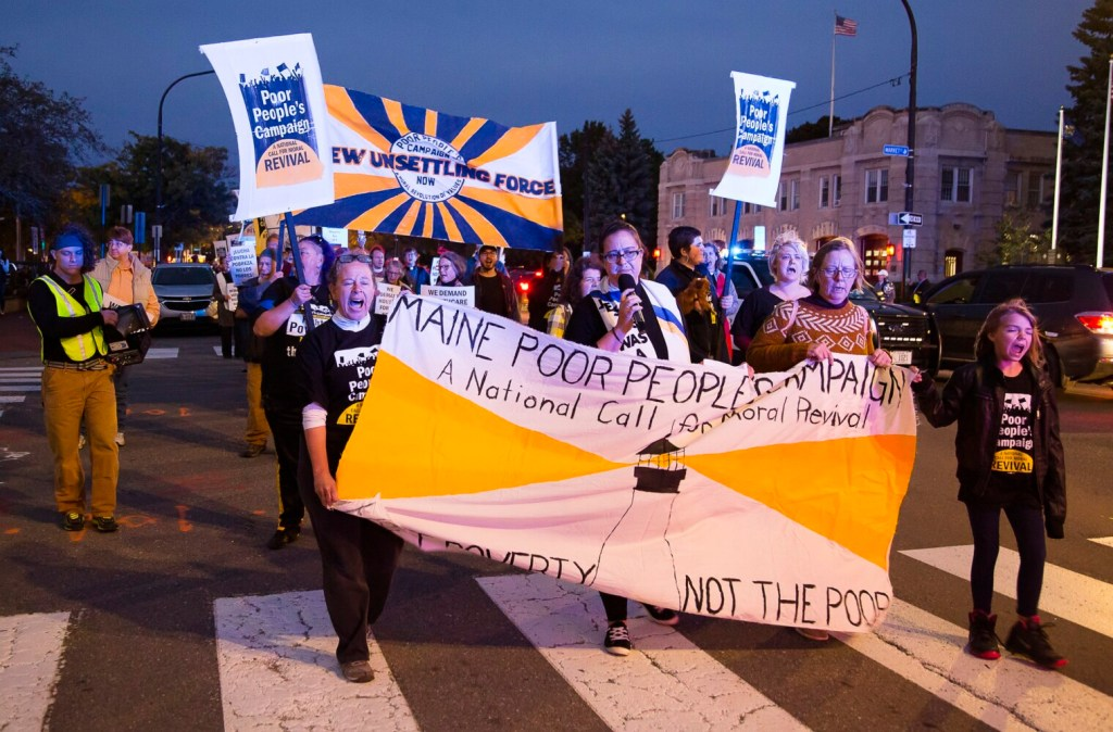 More than 300 people marched down Congress Street on Thursday night as part of the Poor People's Campaign, a national effort to focus attention on poverty, racism and ecological injustice.