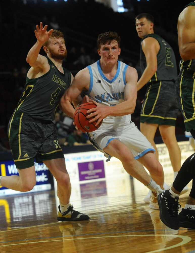 7107# 02menshoops BANGOR, MAINE - OCTOBER 27, 2019 University of Maine's Andrew Fleming takes the ball through Bruce St, Peter, left, in Bangor, Maine Sunday October 27, 2019, 2019. (Staff photo by Rich Abrahamson/Morning Sentinel)