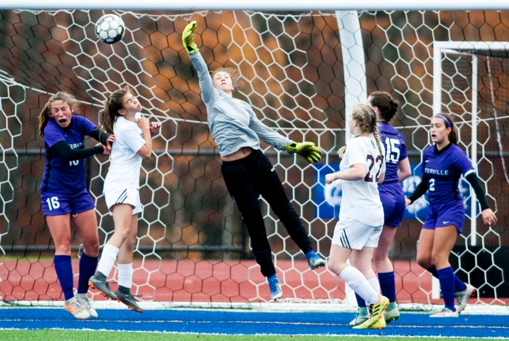 Waterville goalie Jacie Richard (35) makes a punch save on a corner kick as Maine Central Institute's Kayla French, second from left, tries to score on a header in front of Waterville defenders Jayda Murray (16) and Lindsay Given (15) during a Class B North quarterfinal game last week at Messalonskee High School in Oakland.
