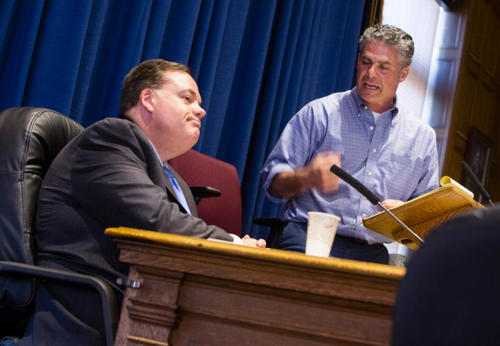 Portland City Manager Jon Jennings looks away from Mayor Ethan Strimling as he speaks during a contentious workshop in 2017 on the role of an elected mayor. Jennings says he might re-evaluate his future with the city if Strimling is re-elected.