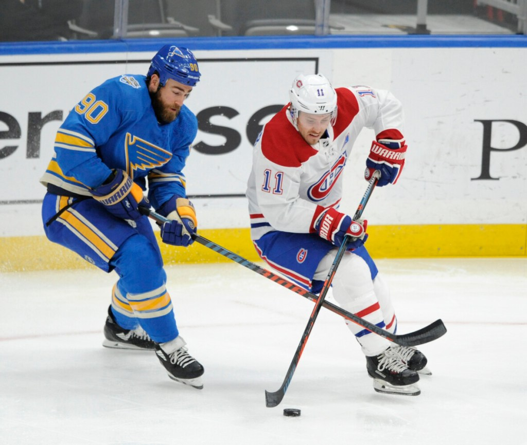 Montreal's Brendan Gallagher (11) battles for the puck with St. Louis' Ryan O'Reilly during the Canadiens' 5-2 win on Saturday in St. Louis.