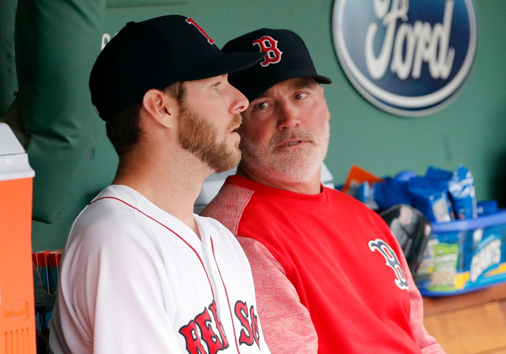 Dana LeVangie, right, talking with Chris Sale, was relieved as the Red Sox pitching coach on Tuesday.