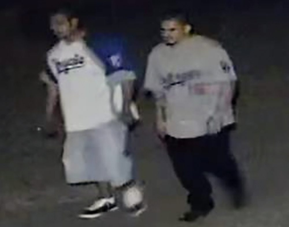 This frame grab from surveillance video provided by the Kansas City, Kan. Police Department shows two suspects authorities are looking for in connection with a fatal shooting at a bar early Sunday in Kansas City.
