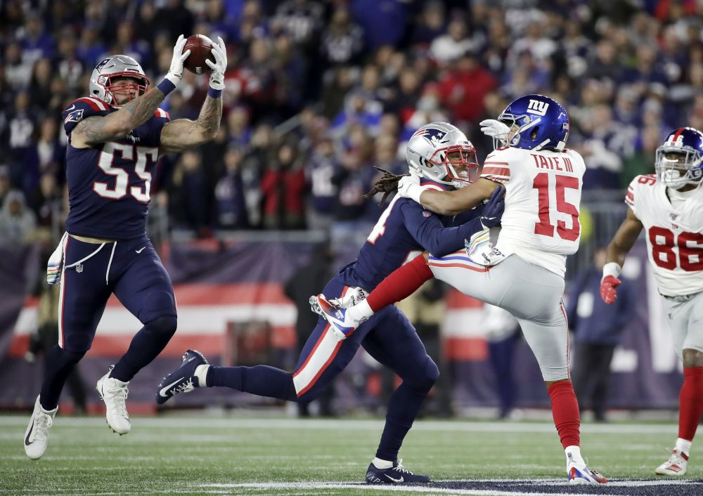 New England Patriots defensive end John Simon (55) intercepts a pass intended for New York Giants wide receiver Golden Tate (15) in the first half of Thursday's game.