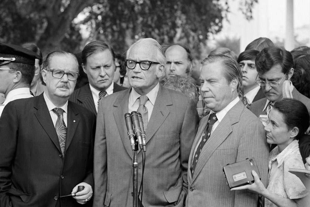 """Sen. Barry Goldwater, R-Ariz., center, speaks to reporters after meeting with President Richard Nixon at the White House to discuss Nixon's decision on resigning. Flanked by Senate Republican Leader Hugh Scott of Pennsylvania, left and House Republican Leader John Rhodes of Arizona, right, Goldwater said Nixon has made """"no decision"""" on whether to resign. The three top Republican leaders in Congress paid a solemn visit to Nixon, bearing the message that he faced near-certain impeachment due to eroding support in his own party on Capitol Hill. Nixon, who'd been entangled in the Watergate scandal for two years, announced his resignation the next day."""
