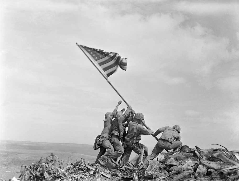 The Marine Corps has corrected the identity of another of the men who were photographed raising the American flag at Iwo Jima during World War II.