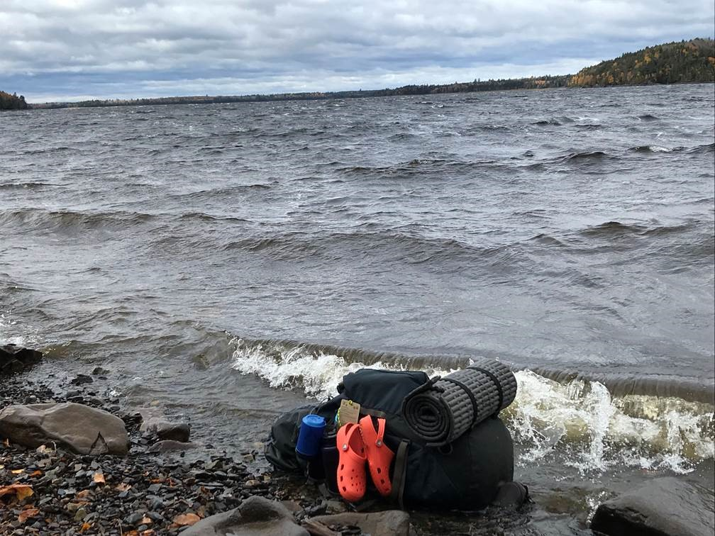 Gear washed ashore on Ripogenus Lake in Piscataquis County, where the Maine Warden Service rescued a group of canoeists after their boats overturned in the wind-whipped waves Friday.