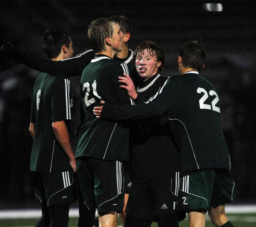 Mount View senior Elijah Allen, facing, celebrates with teammates after the Mustangs defeated George Stevens Academy in the Class C North title game Tuesday in Hampden.
