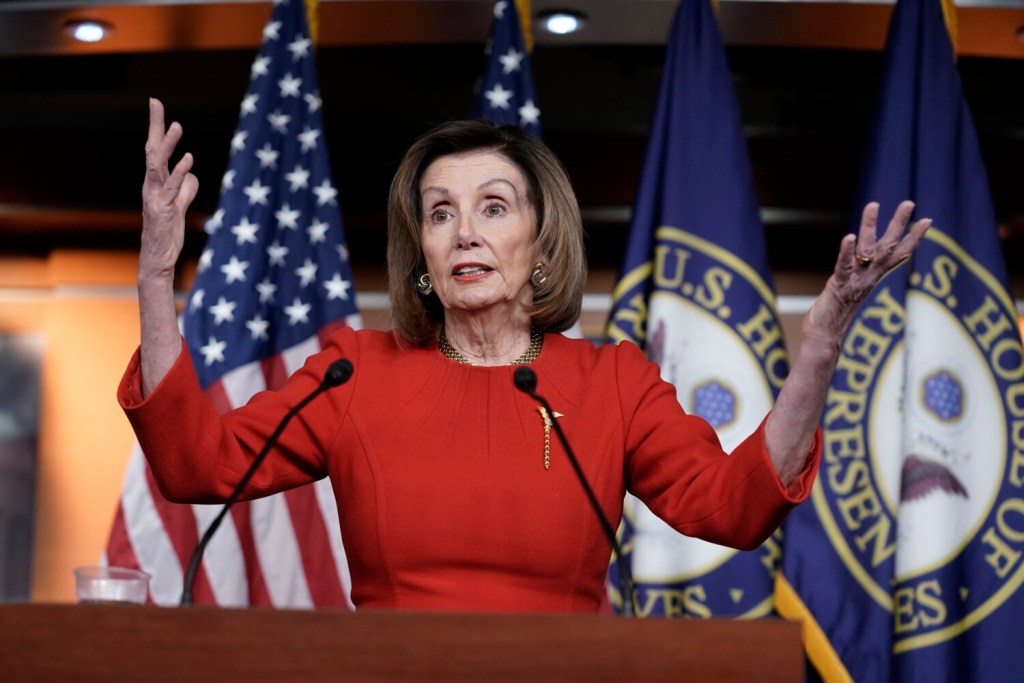 """House Speaker Nancy Pelosi, D-Calif., meets with reporters at the Capitol in Washington on Thursday. Pelosi said the new trade agreement with Mexico and Canada was """"light years"""" ahead of what the administration negotiated with Canada and Mexico. """"We knew we could do better,"""" Pelosi said."""