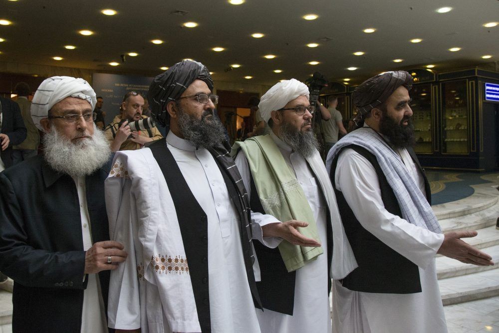 Mullah Abdul Ghani Baradar, the Taliban group's top political leader, second left, arrives with other members of the Taliban delegation for talks in Moscow, Russia., in May. On Saturday, U.S. peace envoy Zalmay Khalilzad met with Afghanistan's Taliban since last September when President Trump declared a near-certain peace deal with the insurgents dead.