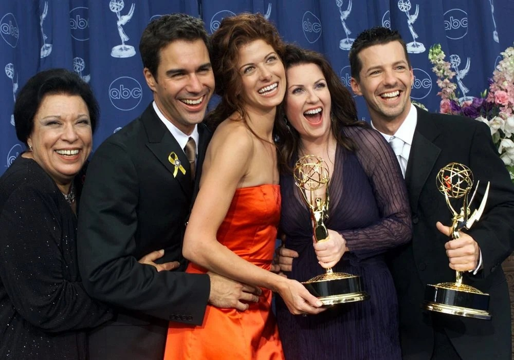 """From left: Shelley Morrison, Eric McCormack, Debra Messing, Megan Mullally and Sean Hayes celebrate their awards for their work in """"Will & Grace"""" at the 52nd annual Primetime Emmy Awards in Los Angeles. Morrison, who played the memorable maid Rosario, has died. Publicist Lori DeWaal said Morrison died Sunday at Cedars-Sinai Medical Center in Los Angeles from heart failure. She was 83."""