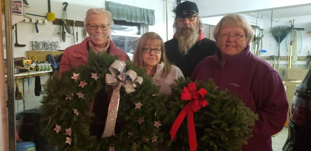 From left, Carla McCorrison, Susan St. Clair, Michael Robinson, and Deborah Dyer display wreaths they and other family members made. The wreaths will be placed at the memorial in Jacksonville, Florida, for the crew of the El Faro.