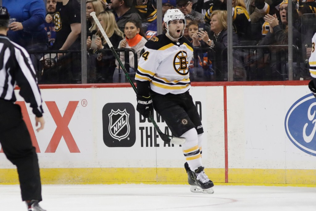 Boston's Jake DeBrusk celebrates after scoring a goal in the second period of Bruins' 3-2 win over the New York Islanders on Saturday in New York.