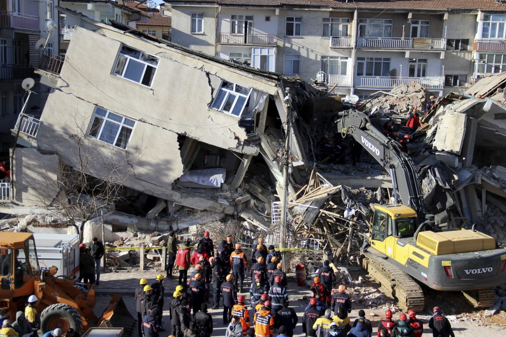 Rescuers work on a collapsed building after an earthquake struck in Elazig, Turkey, on Saturday.