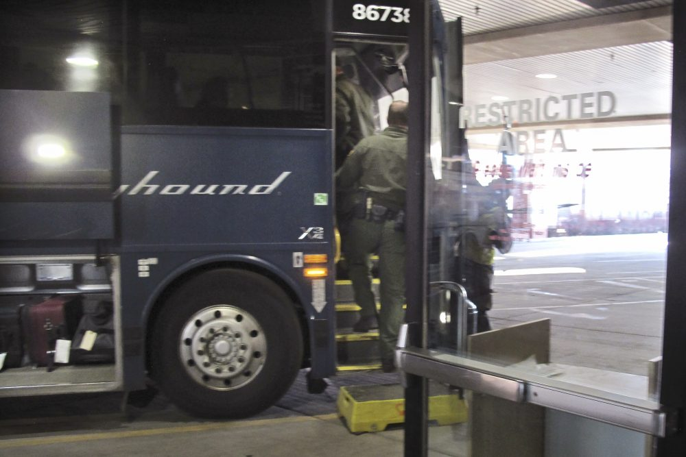 Agents for Customs and Border Protection board a Greyhound bus headed for Portland, Ore., at a terminal for buses and Amtrak in Spokane, Wash., on Thursday. A Customs and Border Protection memo obtained by the Associated Press confirms that bus companies such as Greyhound do not have to allow Border Patrol agents on board to conduct routine checks for illegal immigrants, contrary to Greyhound's long insistence that it has no choice but to let the agents on board.