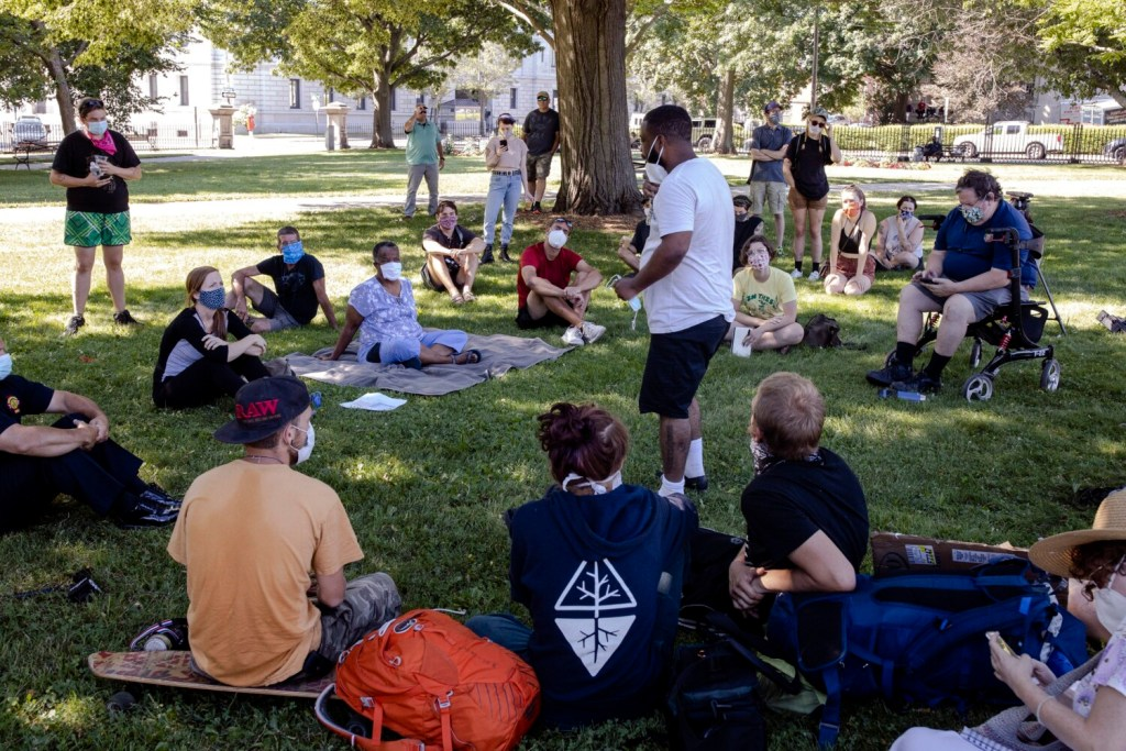 Joshua Rezendez tells his story to city officials during a listening session at Lincoln Park on Wednesday, July 29, 2020. The meeting, attended by Mayor Kate Snyder, Fire Chief Keith Gautreau, and city councilors Spencer Thibodeau and Jill Duson, was held to hear out the organizers, participants and allies who are holding the tent-out outside of City Hall.