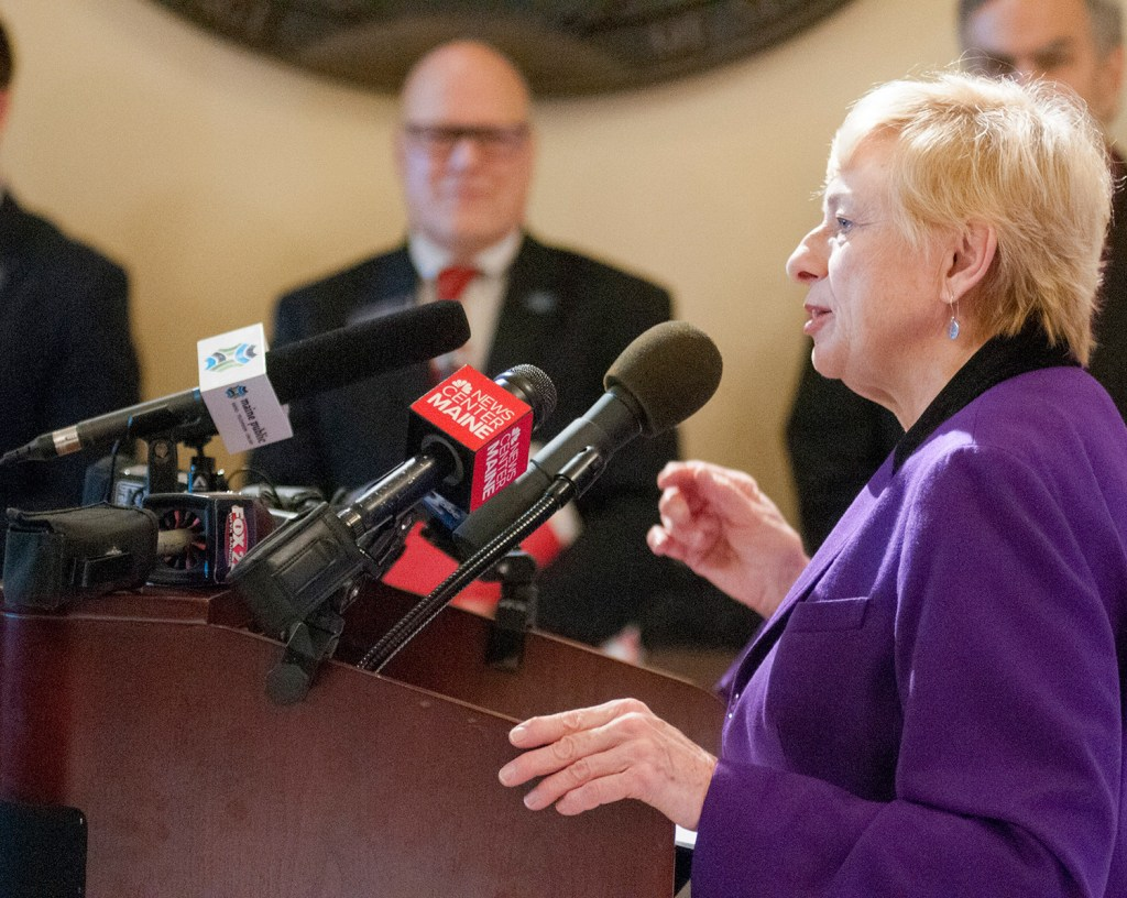 """Gov. Janet Mills speaks at a news conference Tuesday at the State House. She said, """"It is time we build more affordable housing for seniors just as the voters intended."""""""