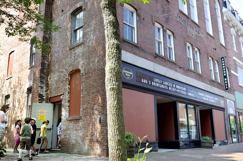Children return to a workshop Monday at Johnson Hall in Gardiner. A fundraising effort is underway to restore the historic theater on Water Street.