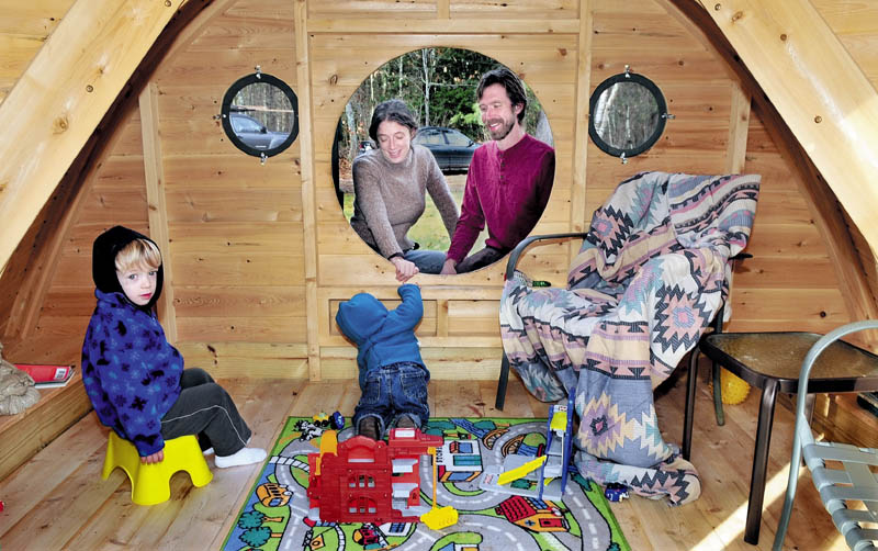 Melissa and Rocy Pillsbury watch from a round doorway as their children Richard, left, and Maximus play in one of the Hobbit Hole playhouses they make for their Wooden Wonders business in Unity. The buildings are designed from the J.R.R. Tolkein novels.