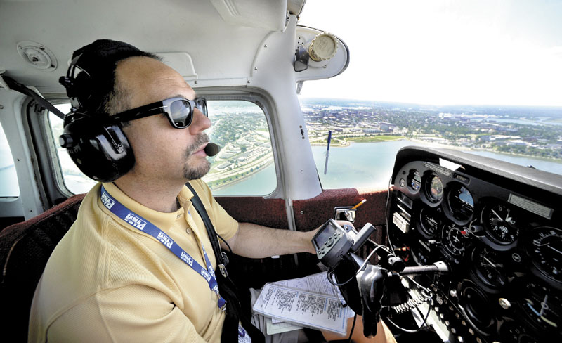 Pilot Jim Stenberg with the Bald Eagle Flying Club enjoys flying his club's Cessna172 around Portland from the Jetport.