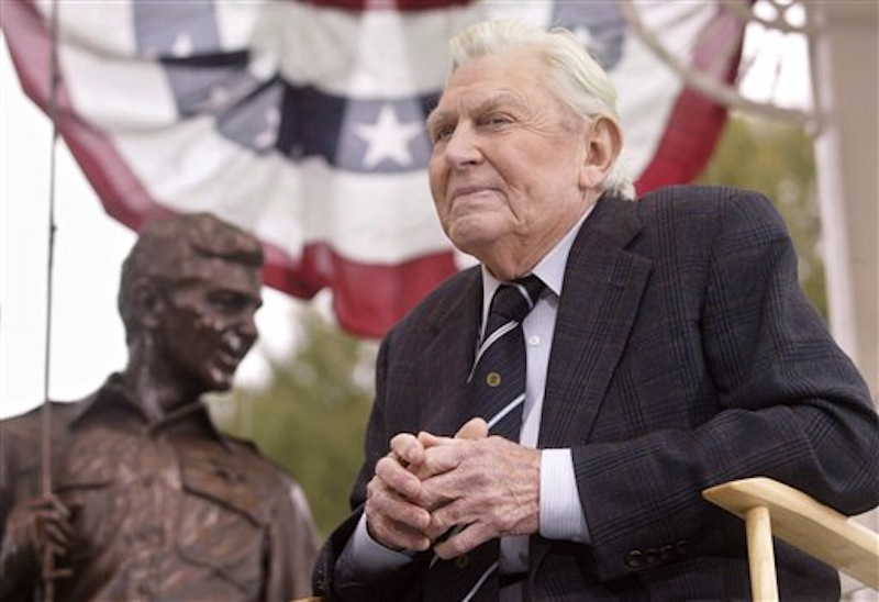 """This Oct. 28, 2003 file photo shows actor Andy Griffith sitting in front of a bronze statue of Andy and Opie from the """"Andy Griffith Show,"""" after the unveiling ceremony in Raleigh, N.C. Griffith, whose homespun mix of humor and wisdom made """"The Andy Griffith Show"""" an enduring TV favorite, died Tuesday, July 3, 2012 in Manteo, N.C. He was 86. (AP Photo/Bob Jordan, File)"""