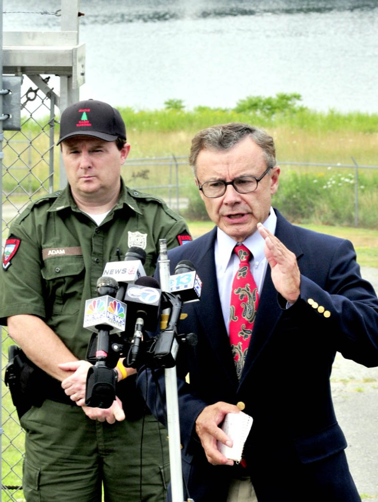 UPDATE: Department of Public Safety Spokesman Steve McCausland, right, gives an update on the extensive search for Ayla Reynolds along the Kennebec River, background, done on Tuesday by several agencies. At left is Lt. Kevin Adam of the Maine Warden Service.
