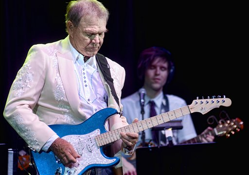 Glen Campbell performs with members of his family in Biloxi, Miss., last July.