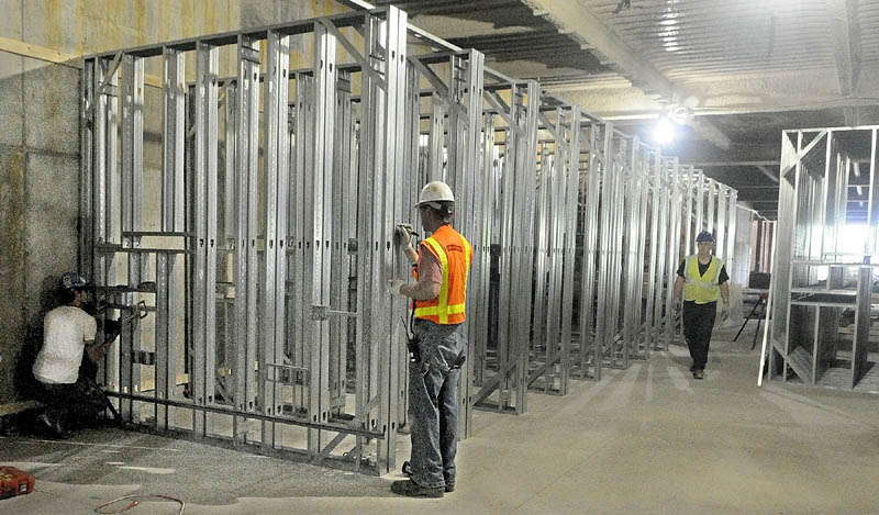Workers frame walls at MaineGeneral's new regional hospital under construction in North Augusta in this May 27, 2012, photo. The $312 million project was expected to generate 400 to 500 construction jobs over the summer.