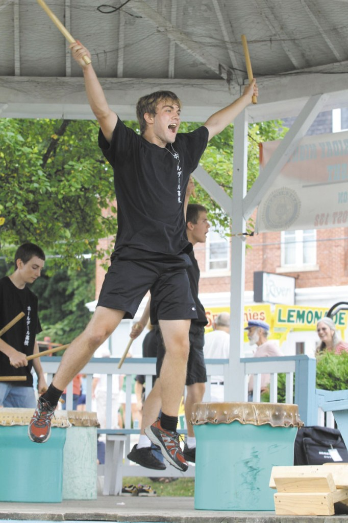 Greg Plourde of Dresden performs with the Hall-Dale Taiko Drummers at Richmond Days on Saturday. The group is comprised of Hall-Dale High School students and is led by Naoto Kobayashi.