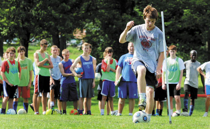 SETTING AN EXAMPLE: Messalonskee High School senior midfielder Jarrod Simpson demonstrates a dribbling drill during the first day of soccer practice in Oakland on Monday. The Eagles are the defending Eastern Maine Class A champs.