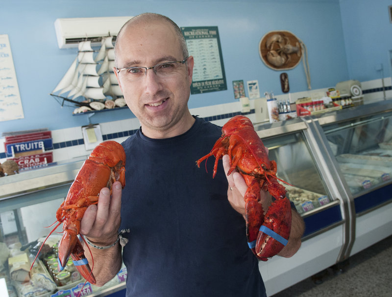"""Maurice Guimond manages the Moncton Fish Market in Moncton, New Brunswick. """"Think about going into work one day and having your boss tell you that you're going to make $2 less an hour. That's what has happened to these lobstermen,"""" he said."""