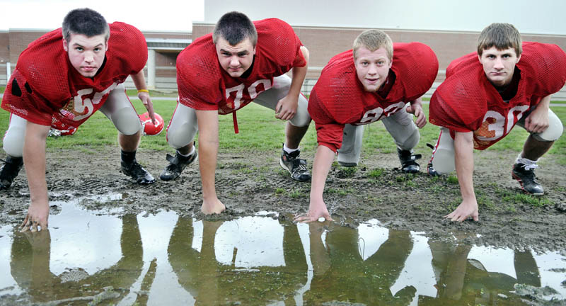 MAKING PLAYS: From left, are Sam Hopkins, Josh Woodward, Eric Cook and Keith Cloutire are part of a Cony High School defense that is allowing 16.3 points per game.