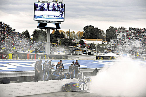 VICTORY LANE BOUND: Jimmie Johnson celebrates his win with a burnout with his crew after winning the NASCAR Sprint Cup Series race Sunday at Martinsville Speedway in Martinsville, Va.