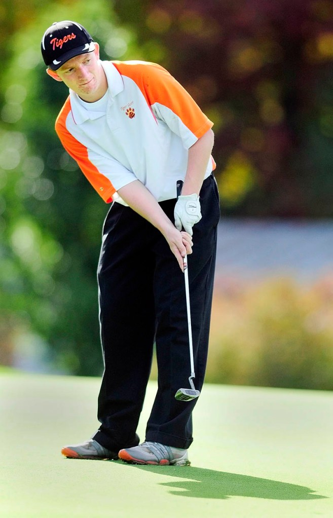 Gardiner's Austin Moore watches his putt on 18th green of Arrowhead course during the Kennebec Valley Athletic Conference qualifier tournament on Tuesday at Natanis Golf Club in Vassalboro.