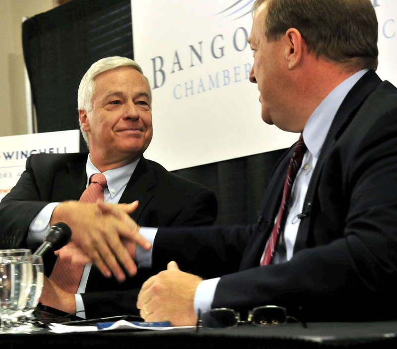 Staff photo by David Leaming U.S. Rep. Mike Michaud, left, and challenger Sen. Kevin Raye shake hands following a debate in Bangor on Tuesday.