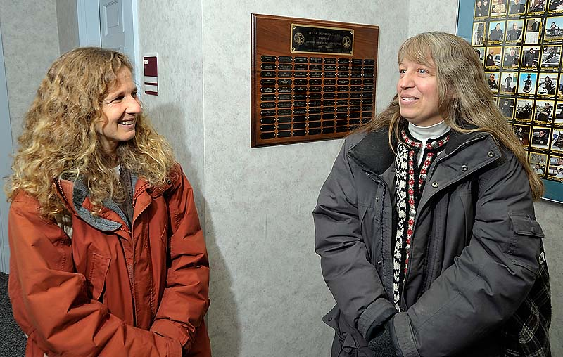 Laura Minervino, left, and Robin Elliott have been committed for the past 23 years and were delighted to get their license as same-sex couples received marriage certificates Saturday at South Portland City Hall. They have a wedding planned at the Victoria Mansion next month.