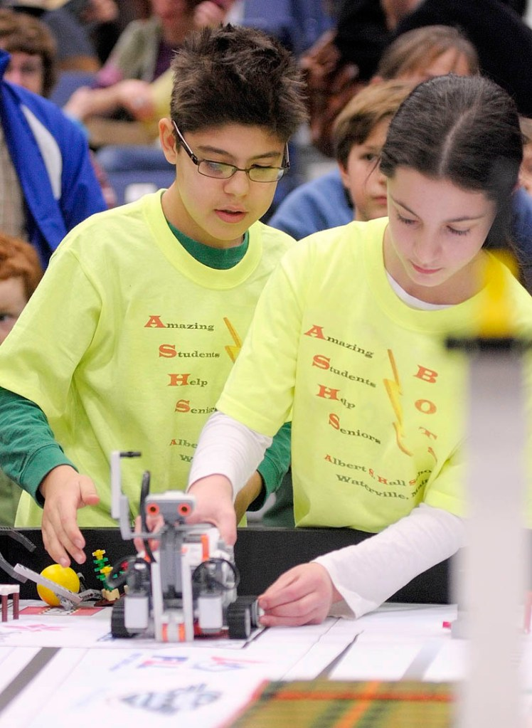 Alex Millones, left, and Abigail Bloom, from the Albert S. Hall School in Waterville, set up their team's robot to compete at the 13th annual Maine First LEGO League Championship on Saturday, at the Augusta Civic Center.