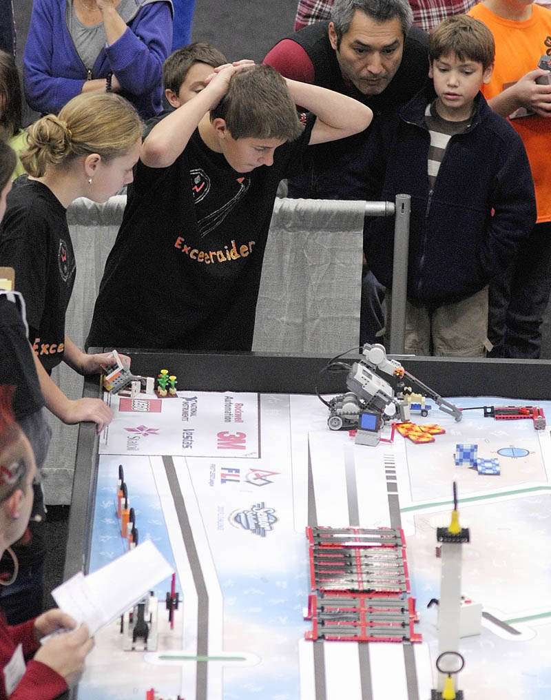 Adrienne Lakey, left, and Noah Michaud, of Winslow Junior High School, watch their team's robot to compete at the 13th annual Maine First LEGO League Championship on Saturday, at the Augusta Civic Center. Only two members at a time can stand beside the table and run the robot.