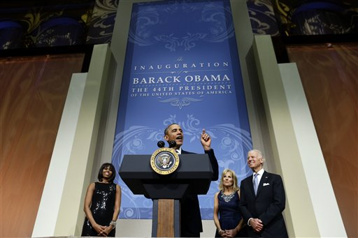 President Barack Obama and first lady Michelle Obama, Vice President Joe Biden and Jill Biden, speak to supporters and donors at an inaugural reception for the 57th Presidential Inauguration at The National Building Museum in Washington, Sunday, Jan. 20, 2013. (AP Photo/Charles Dharapak)
