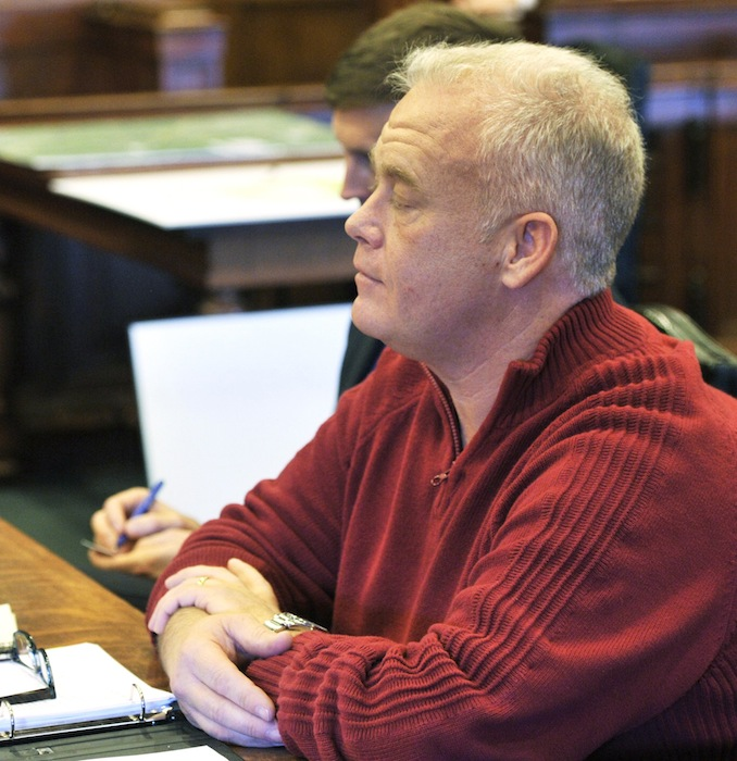Barry Spencer listens as the judge gives the jury instructions prior to opening arguments on Monday, Feb. 4, 2013.
