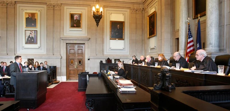 Assistant District Attorney Patrick Gordon takes questions from justices of the Maine Supreme Judicial Court in Portland on Wednesday, February 13, 2013. The court heard oral arguments in the appeal by prosecutors the dismissal of invasion of privacy charges against Mark Strong, Sr.