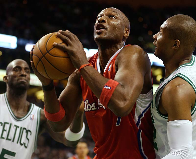 Lamar Odom of the Clippers drives toward the basket while under pressure from Boston's Kevin Garnett, left, and Leandro Barbosa in Sunday's game at TD Garden. The Celtics won, 106-104.